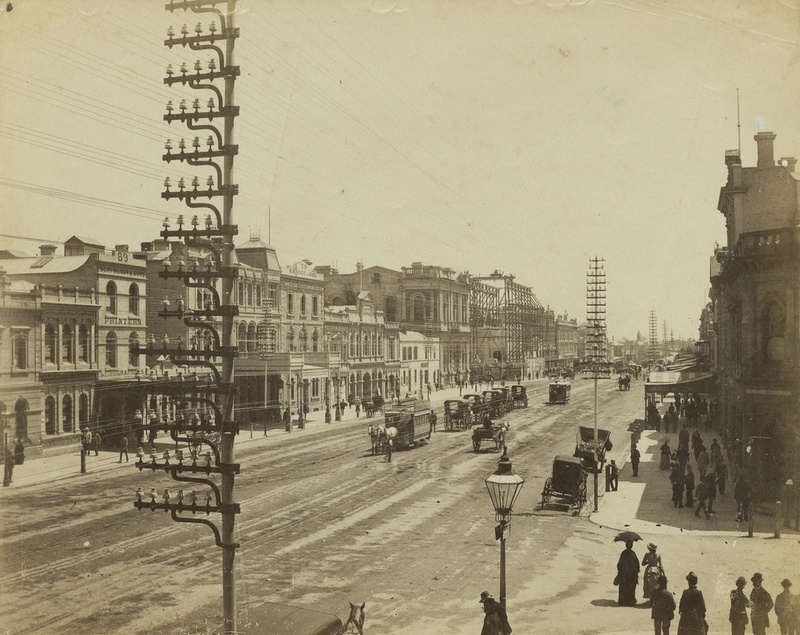 Poles supporting electricity wires on King William Street, approximately 1875
