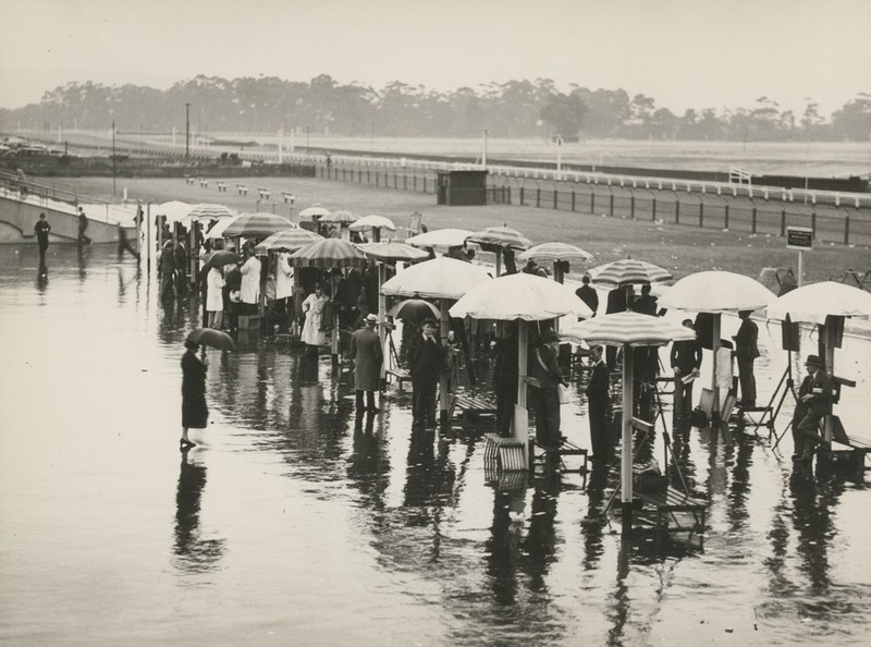 Bookmakers on a rainy day at the races, c. 1937