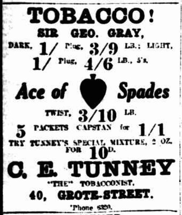 An advertisement for C.E. Tunney's Tobacco Shop in 1918