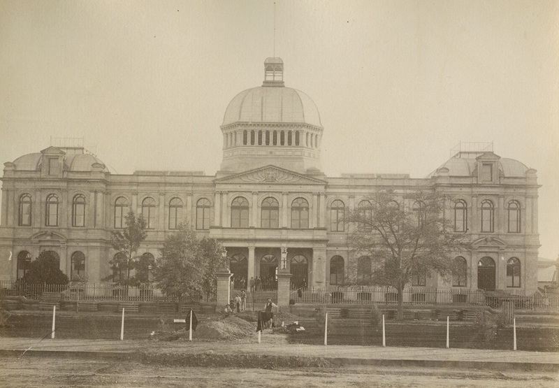 Workers digging a trench in front of the Jubilee Exhibition Building, date unknown